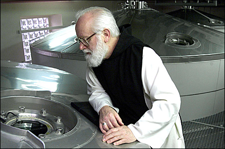 Father Armand Veilleux looks into a brew kettle at a brewery in southern Belgium.