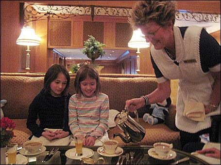 Ana Alvarado, left, and Marley Rozman, both nine, enjoy tea at The St. Paul Hotel.