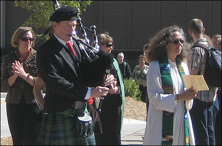The Rev. Sarah Campbell of Mayflower Community Congregational, U.C.C., leads church members in celebration of the completion of Creekside Commons.