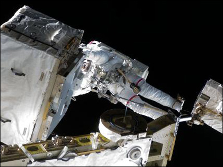 Anchored to a foot restraint, Stefanyshyn-Piper works on the space station.