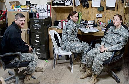 Left to right, Pfc. Scott Swart of Henderson, Minn., Danielle Petree of Winlock, Wash., and Specialist Comfort Stelzer of Ellsworth, Wis.