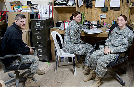 Left to right, Pfc. Scott Swart of Henderson, Minn., Danielle Petree of Winlock, Wash., and Specialist Comfort Stelzer of Ellsworth, Wis.
