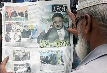 A man in Karachi checks news of President Pervez Musharraf's resignation.