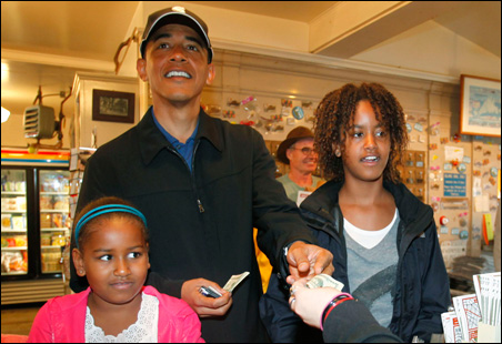 President Barack Obama with daughters Sasha, left, and Malia at Alley's General Store in West Tisbury, Martha's Vineyard, Aug. 30, 2009.