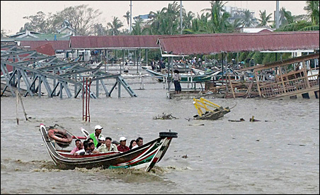 A swollen river, destroyed wharves in Yangon, Myanmar, are among the many challenges facing survivors since Cyclone Nargis hit.