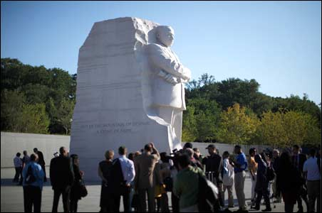 A crowd gathers on the National Mall to view the new Dr. Martin Luther King Jr. memorial.