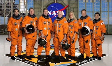 From left: astronauts Gregory E. Chamitoff, Michael E. Fossum, STS-124 mission specialists; Kenneth T. Ham, pilot; Mark E. Kelly, commander; Karen L. Nyberg, Ronald J. Garan and Japan Aerospace Exploration Agency's Akihiko Hoshide, mission specialists.