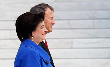 Supreme Court Justice Elena Kagan walks back into the Supreme Court building with Chief Justice John Roberts after her investiture ceremony on Friday.