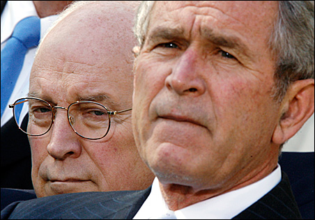 Vice President Dick Cheney listens over the shoulder of President Bush as the president speaks to reporters in the Rose Garden.