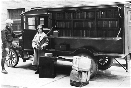 Hennepin County Library Director Ethel Berry in front of a book wagon, the early 20th-century version of today's bookmobile