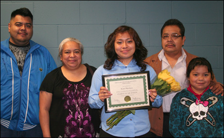 Graduating senior Kiara Machuca shown with her family.