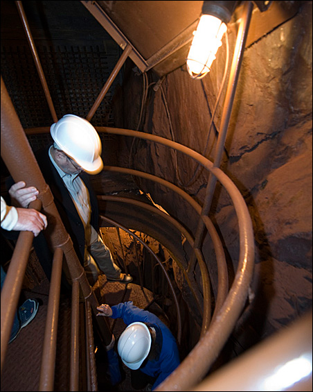 Workers take steps down the shaft leading to the underground laboratory.