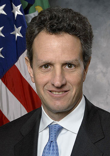 Geithner flashes his trademark perma-smirk.