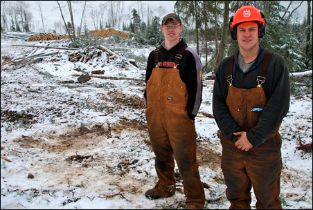 Colee Johnson, left, and his brother Skyler, right, along with their younger brother, Clay, have found a way to carve careers and a business out of the north woods.