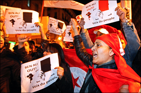 Tunisian people living in France shout slogans as they demonstrate against Tunisian President Zine al-Abidine Ben Ali in Marseille.