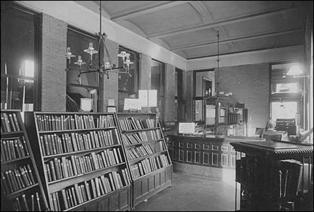 A 1895 photo of the circulation desk in the original Minneapolis Public Library