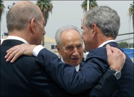 Israeli President Shimon Peres, center, stands with President Bush and Prime Minister Ehud Olmert during a welcoming ceremony near Tel Aviv.