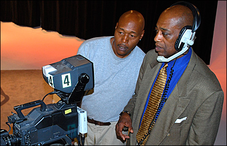 Director Ron Kenebrew and host Ted Dennis discuss a camera shot.