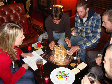 The teams start the gingerbread house building challenge