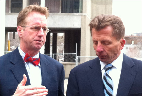 Mike Christenson, left, and George Sherman discussing Riverside Plaza's   renovation.