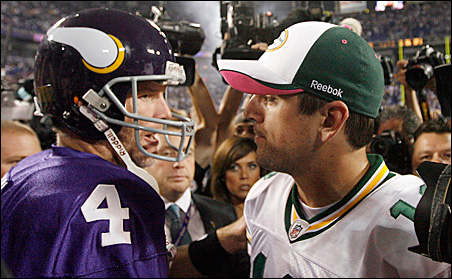 Vikings quarterback Brett Favre talks with Packer quarterback Aaron Rodgers on the field after the Monday, Oct. 5 game at the Metrodome.