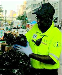 An ambassador empties the trash on Nicollet Mall.