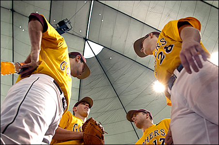 Gopher players confer Sunday during their 11-9 victory over Northern Iowa at the Metrodome.
