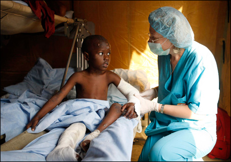 Disefit, a four-year-old victim of the earthquake, sits in a hospital in Port-au-Prince.