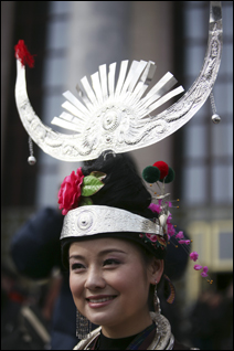 A delegate from a Chinese ethnic minority group arrives at the Great Hall of the People on Friday.