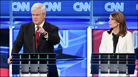 Michele Bachmann listening to Newt Gingrich during Tuesday night's debate.