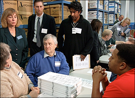 Ever since the first day of the actual recount, such as this scene in Minneapolis, the two campaigns have held dueling briefings to offer their partisan take on the proceedings.
