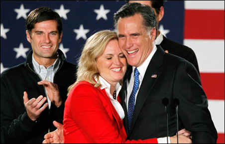 Mitt Romney hugging his wife Ann at his Tuesday night rally in Des Moines.
