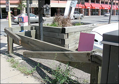 Broken fences and weedy pavement make much of downtown Minneapolis unappealing.