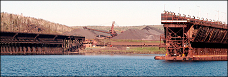 Huge stockpiles of taconite sit behind idle ore docks in Two Harbors.
