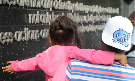 Friends and family members get their first look at the memorial wall.