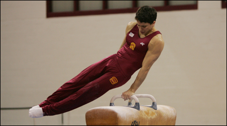 U of M Olympic hopeful Guillermo Alvarez works out on the pommel horse.