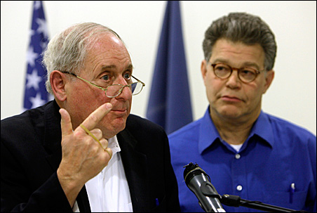 Sens. Carl Levin, left, and Al Franken address journalists during a news conference in Kabul on Wednesday.