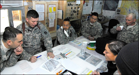 Maj. Shawne Menke briefs the crews on the risks they face going into in Sadr City, Baghdad.