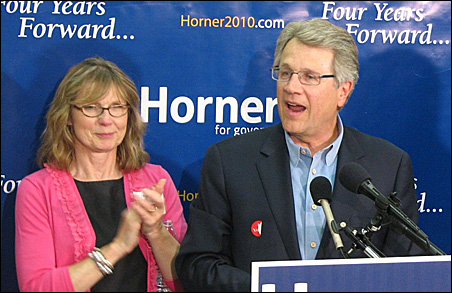 Tom Horner speaks to supporters Tuesday night, with wife Libby, left.
