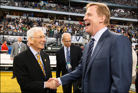NFL Commissioner Roger Goodell, right, who wants to keep the Vikings here, shakes hands with Pittsburgh Steelers owner Dan Rooney before Super Bowl XLV.