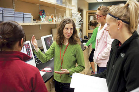 Biosciences Prof. Alison Wallace works with prospective elementary school teachers at a Minnesota State University lab.