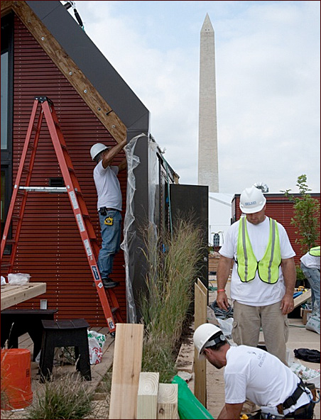 The team from the University of Minnesota works to erect their entry for the 2009 Solar Decathlon.