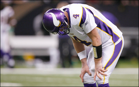 Vikings quarterback Brett Favre puts his head down during the fourth quarter of the NFC Championship game.