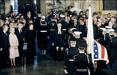 President Jimmy Carter, Muriel Humphrey, Vice President Walter Mondale and Joan Mondale view the procession of Hubert Humphrey's coffin out of the Capitol rotunda.