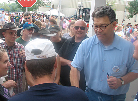 Sen. Norm Coleman and his chief challenger, Al Franken, shown here, showed up for the State Fair's opening day.
