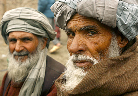 Displaced Afghan men queue Tuesday to receive winter aid from the United Nations High Commissioner for Refugees in Kabul.
