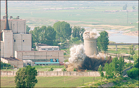 A cooling tower is demolished at a North Korean nuclear plant Friday. North Korea toppled the cooling tower at its plutonium-producing reactor in a symbolic move to show its commitment to a disarmament deal that comes a day after it submitted an inventory
