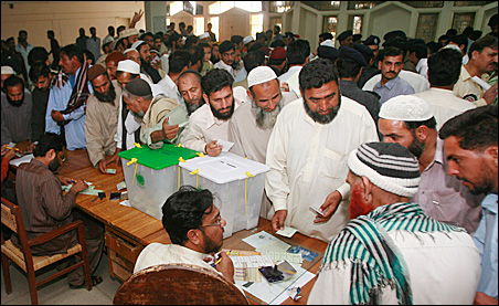 Pakistani voters crowd a polling station in Karachi