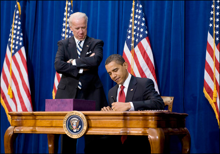 With Vice President Joseph Biden looking on, President Obama signing the stimulus package bill at the Denver Museum of Nature and Science on Tuesday.
