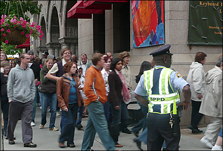 The line of folks waiting to attend the Obama rally snaked throughout downtown St. Paul, way past this group outside Landmark Center.